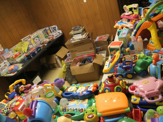 Toys fill the storage spaces of the local non-profit,