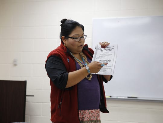 Letitia Moon, an advocate with the Navajo Nation Missing Persons Updates Facebook page, shares information about efforts to locate missing tribal members. She spoke at a conference about human trafficking on Wednesday in Shiprock.