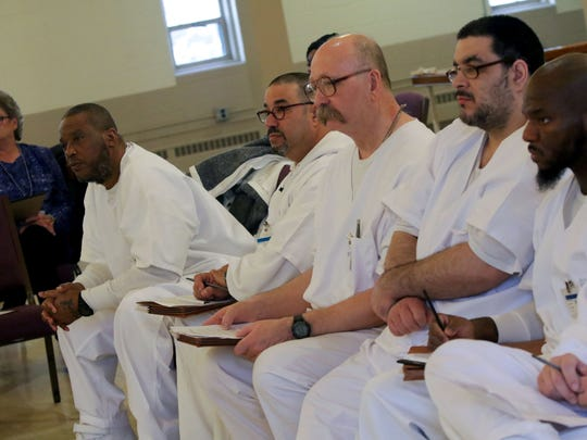 Inmates chosen to speak at the Inmate Advisory Committee meeting at James T. Vaughn Correctional Center listen to staff speak.