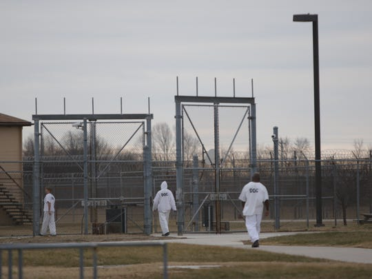 Inmates move between buildings at Jame T. Vaughn Correctional