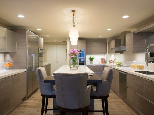 """Long kitchen around an island suggests  a ship's galley, said the owner's son.""""My mother loved to sail and she loved to cook."""" Cabinets are Berloni; appliances are Meile."""