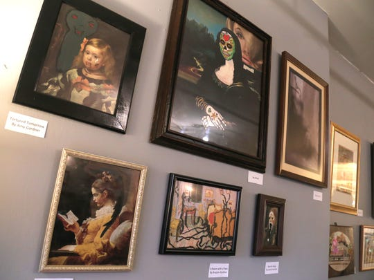 Paintings enhanced by various local artists are now on exhibit in the third annual Monster Paintings at Main Street Books in Mansfield.