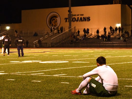 Junior Angel Amezcua sits in exhaustion as the Trojans' CCS title hopes were finished at the end of Tuesday's game.