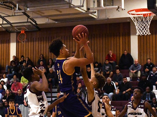 Salinas senior Kasey Cannon elevates for two of his team-high 13 points. Cannon had multiple blocks on the defensive end for Salinas.