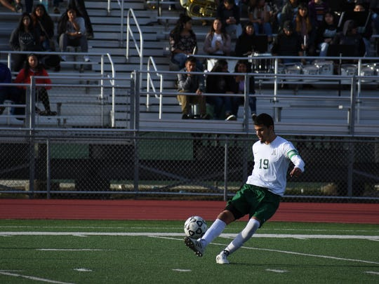 Senior midfielder Jesus Ochoa powers the ball upfield in the first half of Alisal's 3-2 win over Galt in the CIF Norcal Division II Regional Quarterfinals.