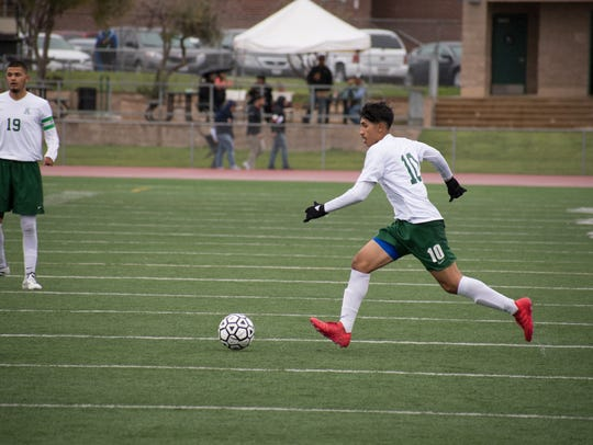 Senior Juan Moya moves to midfield for a cross to senior