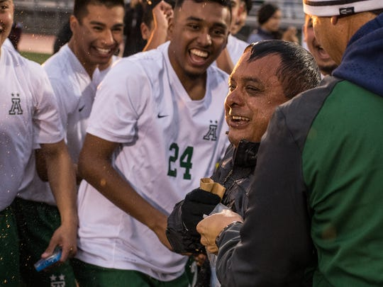Alisal Trojans boys' soccer coach Mark Cisneros, shown here after the Trojans' 2018 NorCal championship game win.