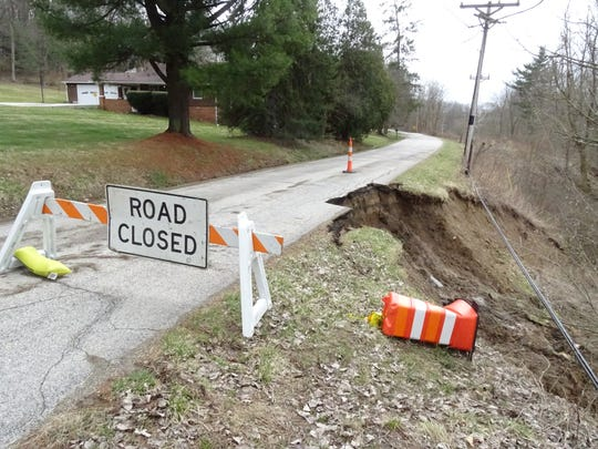 A portion of Smart Road in Mifflin Township slide further into the Rocky Fork River after heavy rains Tuesday evening.