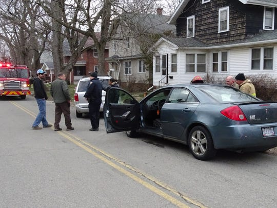 Police talk to witnesses and collect evidence after