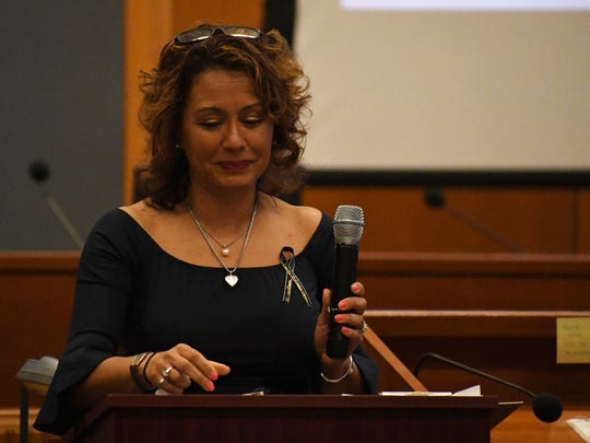 Gigi Bridgers gives a speech about her mother, Sandra McGee Steppuhn. Gigi and her two younger sisters were the Inspirational Speakers of Friday's ceremony honoring victims murdered in Monterey County and talked about the disappearance and loss of their mother in 1982.