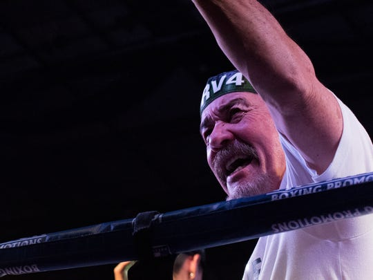 Ruben Villa IV's trainer Max Garcia celebrates the victory that gave Villa the WBO Youth Featherweight title Saturday night at the Salinas Storm House.