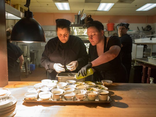 Lady of the House pastry Chef Monica Greer, left, and Chef Kate Williams prepare the sunchoke soup as one course during the Detroit Free Press Top Ten Takeover on Tuesday, April 17, 2018 at Lady of the House in Detroit.