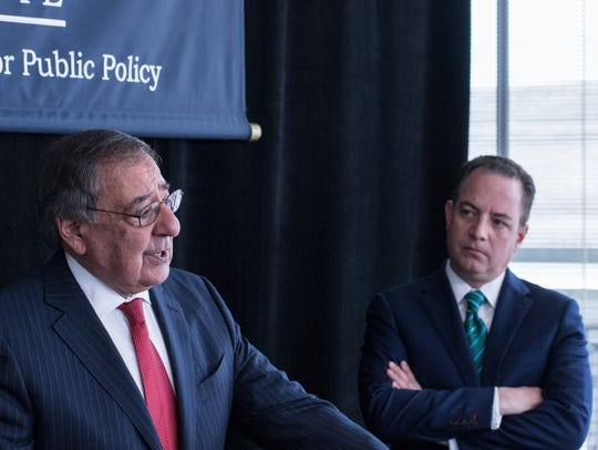 Leon Panetta (right) speaks at a press conference as
