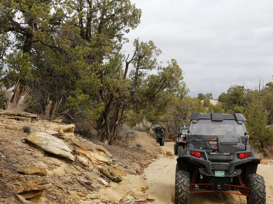 Off-highway vehicles traverse trails Wednesday in the Glade Run Recreation Area near Farmington.