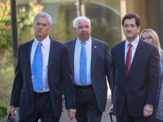 Former Wilmington Trust President Robert Harra Jr. (second from left) arrives at the J. Caleb Boggs Federal Building in October 2017.