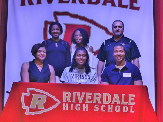 Riverdale senior Kennedy Moore recently signed to play basketball at Berry College in Rome, Ga. Pictured in the front row (l-r) are Tiffany Moore (mother), Kennedy Moore and Donald Moore (father). In the back row (l-r) are Rose Smith (grandmother), Morgan Moore (sister) and Riverdale coach Randy Coffman.