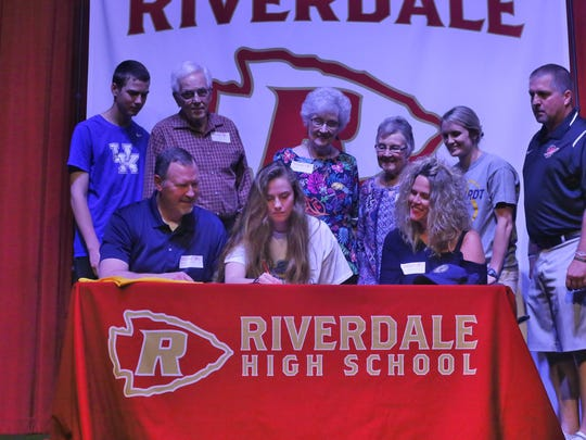 Riverdale senior Brylee Puckett recently signed to play basketball at Reinhardt University in Waleska, Ga. Pictured in the front row (l-r) are Barry Puckett (father), Brylee Puckett and Beverly Puckett (mother). In the back row (l-r) are Brock Puckett (brother), John Oldham (grandfather), Frances Oldham (grandmother), Sue Puckett (grandmother), Brooke Thomas (assistant coach, Reinhardt University) and Riverdale coach Randy Coffman.