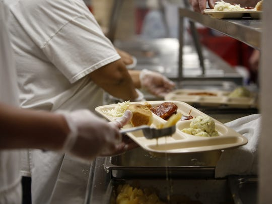 In this file photo, meals are served during a Mother's Day Lunch at the Bonnie Dallas Senior Center in Farmington.
