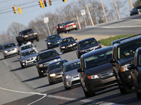 Rush-hour traffic flows along Lancaster Pike at the intersection of Centerville Road.