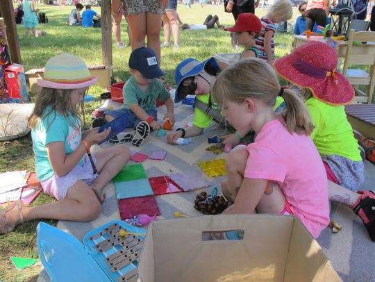 Children played with musical toys on Friday at the Eaux Claires Music and Arts Festival.