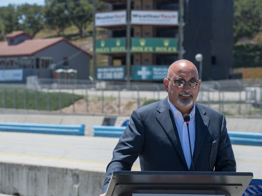 Three-time CART (now IndyCar) champion Bobby Rahal smiles at the press conference on the front straight of Laguna Seca Tuesday. Rahal and many other Laguna Seca racing legends came to celebrate the return of IndyCar to the historic track.