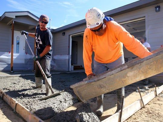 Hard Rock Builders employees Ryan Valdez, left, and
