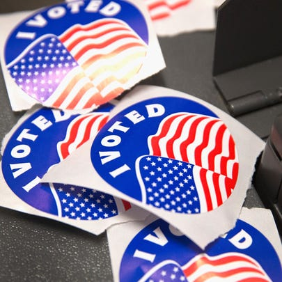 """A pile of """"I Voted"""" stickers, which are handed out"""