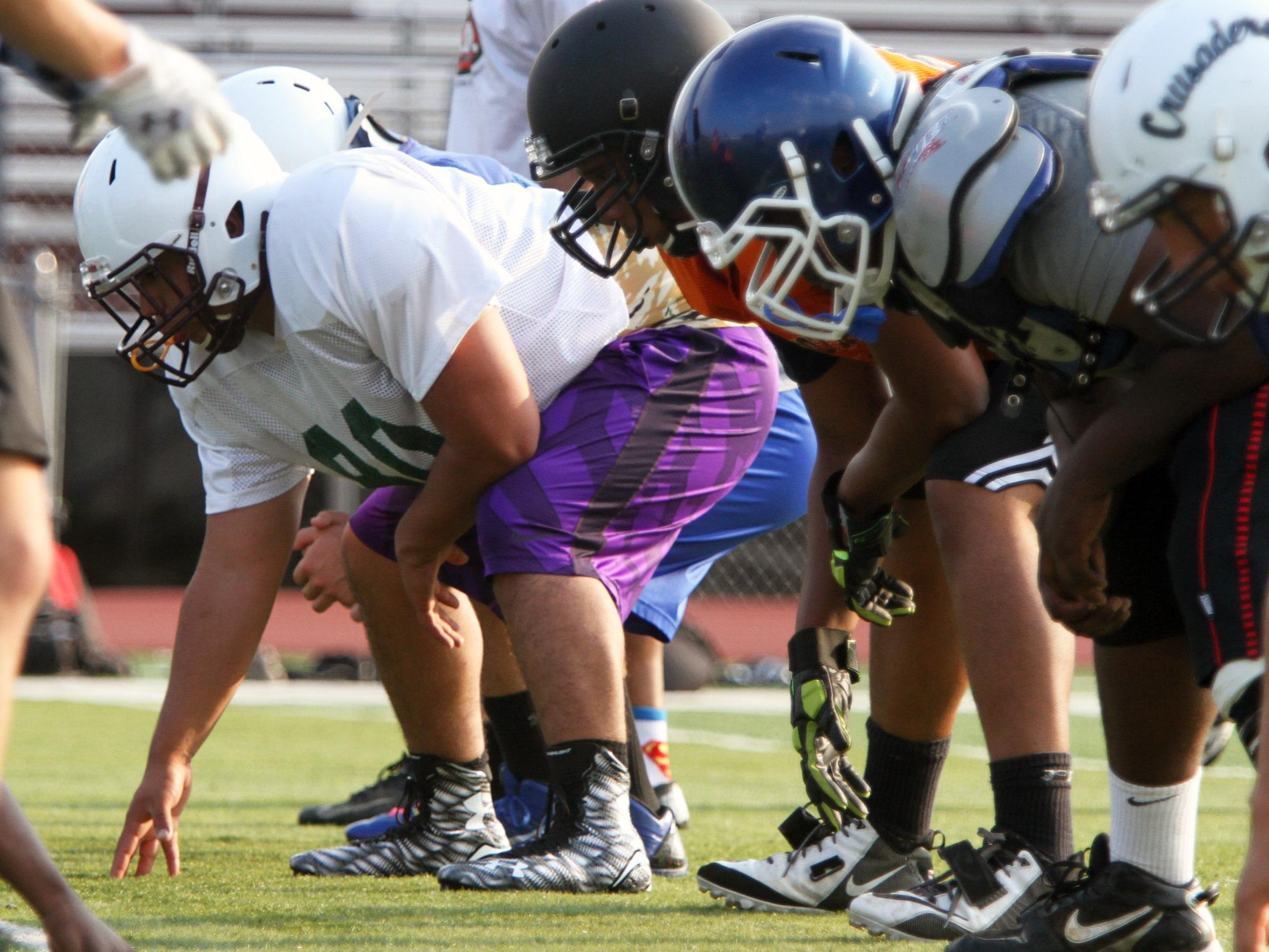 Union County All-Star football players as they prepare for MyCentralJersey.com Snapple Bowl XXII at Union High School on Tuesday July 7,2015. Here New Providence's Pat Morris (left) works during a defensive drill.
