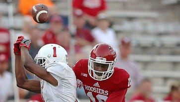 A pass to Ball State Cardinals wide receiver Jordan Hogue (1) is incomplete thanks to defense by Indiana Hoosiers defensive back Rashard Fant (16) during fourth quarter action at Indiana University's Memorial Stadium, Bloomington, Ind., Saturday, September 10, 2016. The Hoosiers beat the Cardinals, 30-20.