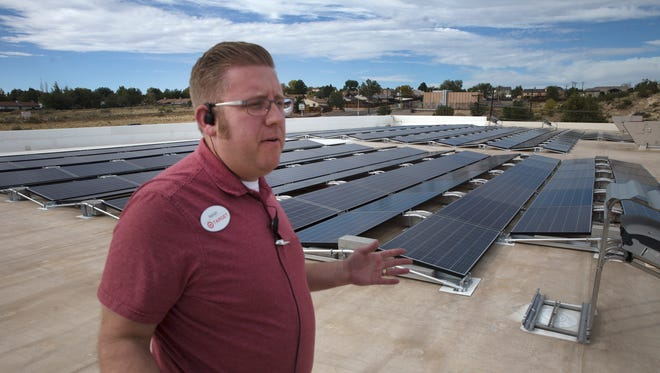 Target General Manager Isaiah Shay shows off Target's new roof top solar panels during a tour on Wednesday, Oct. 11, 2017 in Farmington.