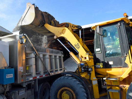 PennDOT employee Eddie Blair uses a front-end loader