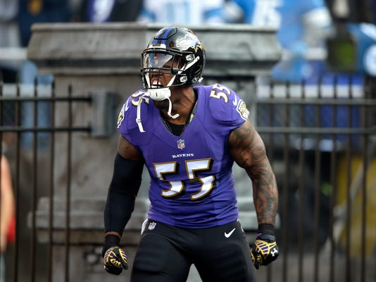 FILE - In this Dec. 3, 2017, file photo, Baltimore Ravens outside linebacker Terrell Suggs runs onto the field as he is introduced before an NFL football game against the Detroit Lions, in Baltimore. Baltimore plays at Pittsburgh on Sunday. (AP Photo/Nick Wass, File)