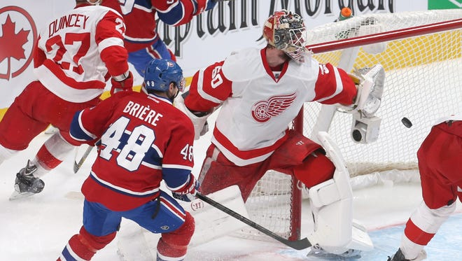 Montreal Canadiens left wing Michael Bournival (49) (not pictured) scores a goal against Detroit Red Wings goalie Jonas Gustavsson (50).