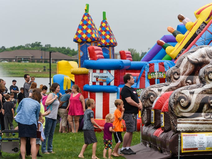 Bounce rides are popular attractions Saturday, June