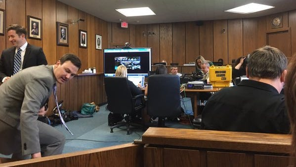 Reporters set up in an overflow room where they were placed to watch Jason Dalton preliminary examination via a remote TV feed.