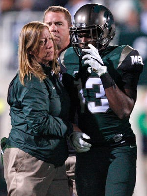 Michigan State cornerback Vayante Copeland walks off the field with an injury during the fourth quarter against Oregon at Spartan Stadium.