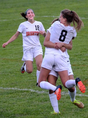 Brighton senior Grace VanKannel (8) celebrates with fellow seniors Baylee Johnston (left) and Emma Shinsky after scoring a goal in a 4-0 win over Howell on Tuesday.