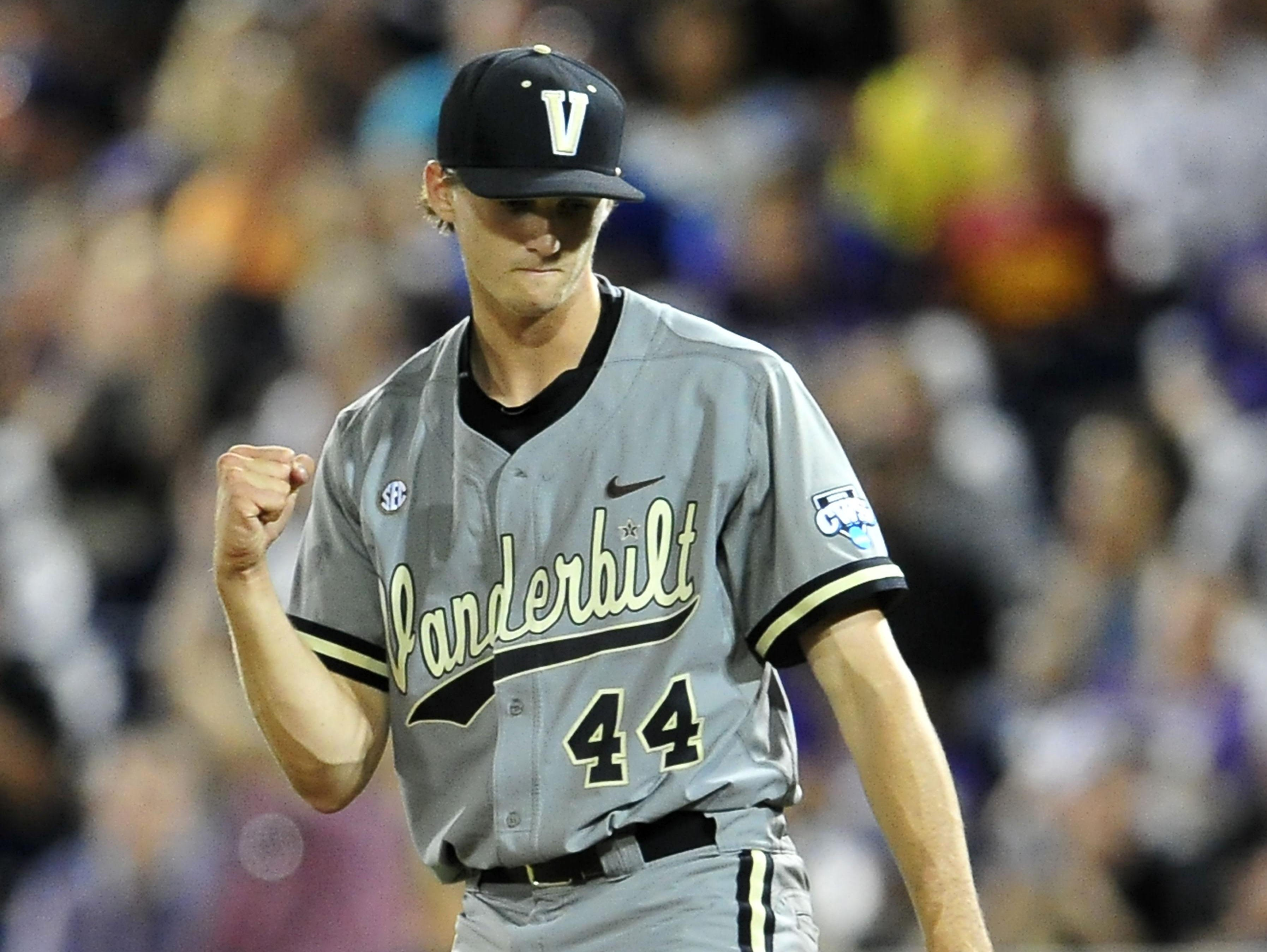 Vanderbilt pitcher Kyle Wright pumps his fist after defeating TCU 1-0 during the College World Series on Tuesday. The Commodores have allowed only three runs in 18 innings.