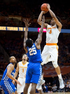 Tennessee's Robert Hubbs III attempts to score while defended by Kentucky's Dominique Hawkins at Thompson-Boling Arena on Tuesday, January 24, 2017. Tennessee beats Kentucky, 82-80.