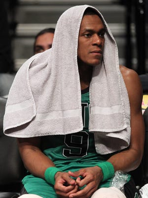Celtics point guard Rajon Rondo watches from the bench during a game in March.