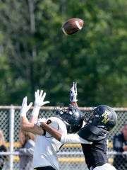 McQuaid's Ben Beauchamp just misses a pass while being