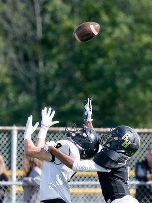 McQuaid's Ben Beauchamp just misses a pass while being chased by Rush-Henrietta's Kailee White in the third quarter at Rush-Henrietta High School.