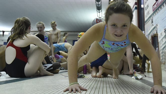 Kailyn Neville catches up on a few push-ups in a new character building program at the Door County YMCA in Sturgeon Bay. The program flows into a swim team. Tina M. Gohr/USA TODAY NETWORK-Wisconsin