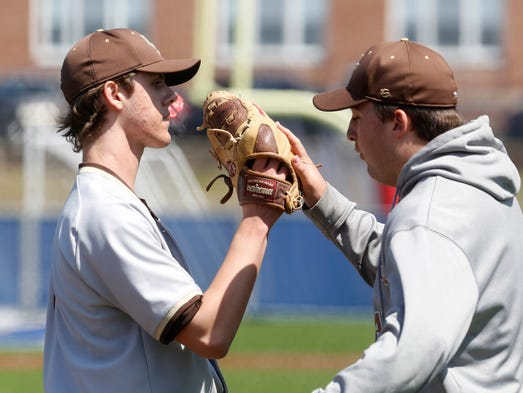 Clarkstown South's Justin Lukasiewicz is congratulated after pitching a shutout in a baseball game against Stepinac, April 19, 2014 at Archbishop Stepinac High School in White Plains. Clarkstown South won, 6-0.