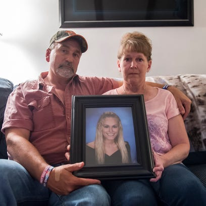 Rich and Shelia Craumer hold a portrait of their late
