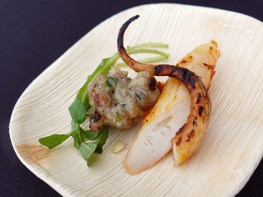 Grilled octopus with Romesco, wild arugula, lemon oil
