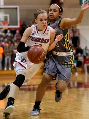 Seymour's Jenna Krause against Beaver Dam's Jada Donaldson during their WIAA division 2 sectional final girls' basketball game on Saturday, March 4, 2017, at Neenah High School.