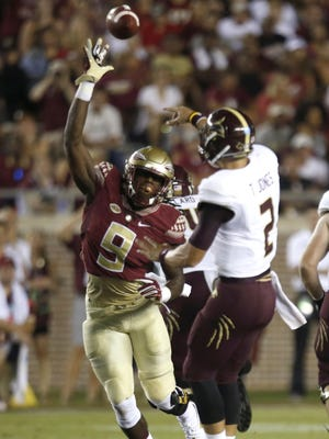 FSU's Josh Sweat was held out of Tuesday's practice with concussion symptoms.