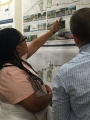 A resident speaks with a consultant Tuesday, June 12, 2018, about the University Avenue corridor plans.