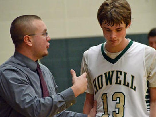 Howell's Tyler Johnson, right, stands with coach Nick